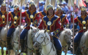 Naadam is a the largest festival in Mongolia and focuses on Mongolian wrestling, horse racing, and archery