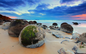 Koekohe Beach in New Zealand is filled with cracked boulders. Because the rocks look like huge eggs, the area is often known as Dragon Egg Beach.
